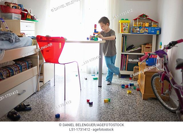 boy playing in his bedroom, Valencia, Spain