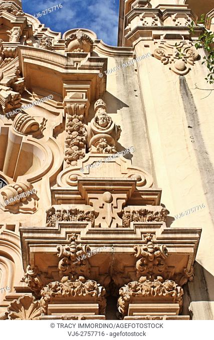 Close up of sculptures to the right, above the entrance to the Casa del Prado in Balboa Park, San Diego, California, USA