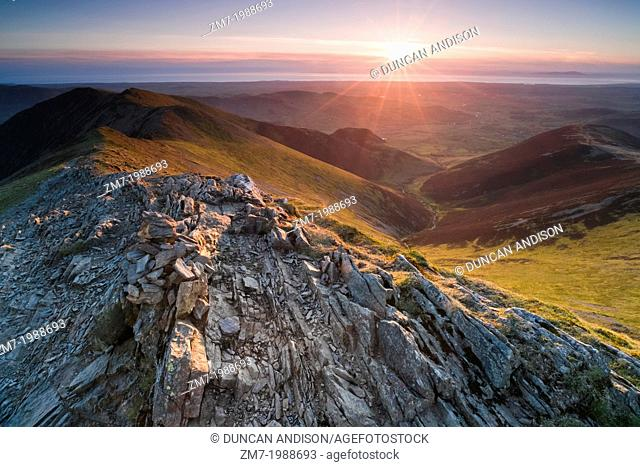 Looking down Hope Gill from the summit of Hopegill Head at sunset in the Lake District. Whiteside to the left and Ladyside right