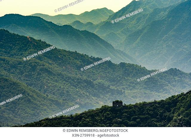 Mutianyu, China - Landscape view of the Great Wall of China mountain range. The wall stretches over 6,000 mountainous kilometers east to west across North China...