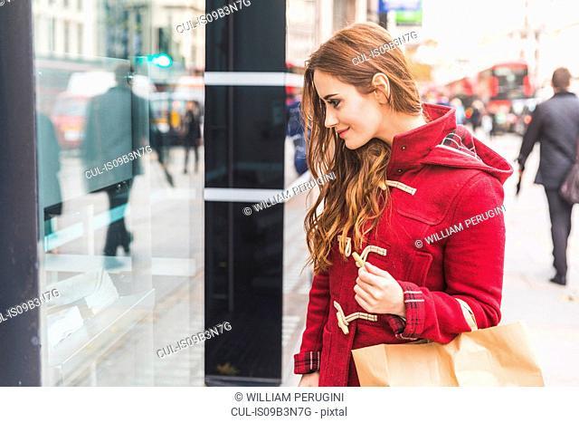 Woman window-shopping, London, UK
