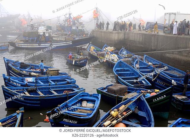 Essaouira fishing harbour in the morning with fog, Morocco, Africa