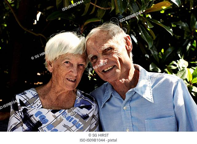 Portrait of happy senior couple in park