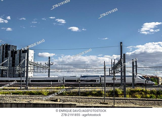 View of a cloudy sky on a track train closed to Atocha station, Madrid city, Spain