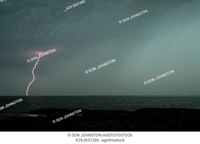 Thunderstorm and lightning strike over Mississagi Strait, Mississagi Lighthouse, Manitoulin Island, Ontario, Canada