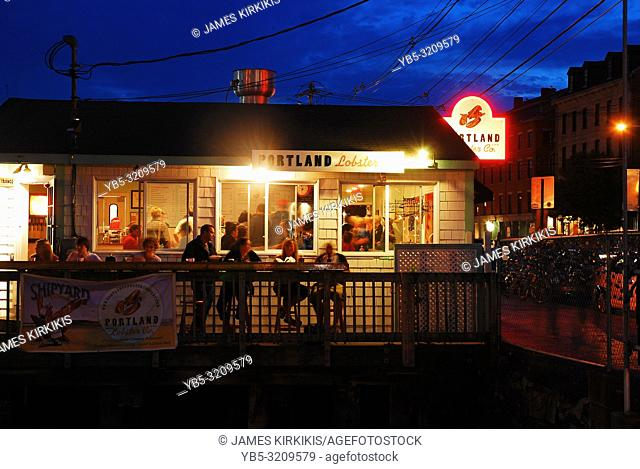 Diners enjoy s summer evening at a lobster shack in Portland, Maine