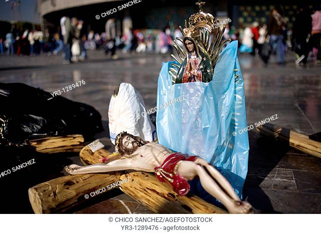 A crucifix and a statue of Our Lady of Guadalupe, Mexico City, December 9, 2010  Hundreds of thousands of Mexican pilgrims converged on the Our Lady of...