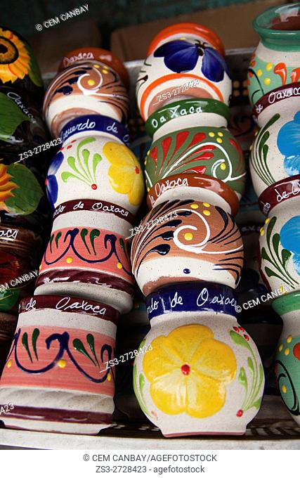 Colorful ceramic jugs and cups for sale in a shop at the historic district, Oaxaca, Oaxaca State, Mexico Central America