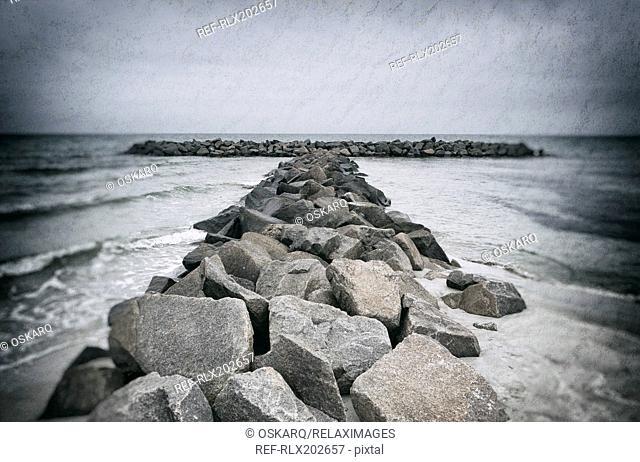 Stone wave barrier break waves north sea ocean