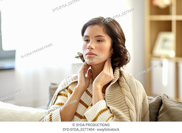 sick woman touching her lymph nodes at home