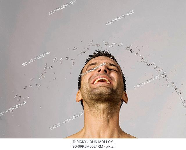 Drops of water around man's head