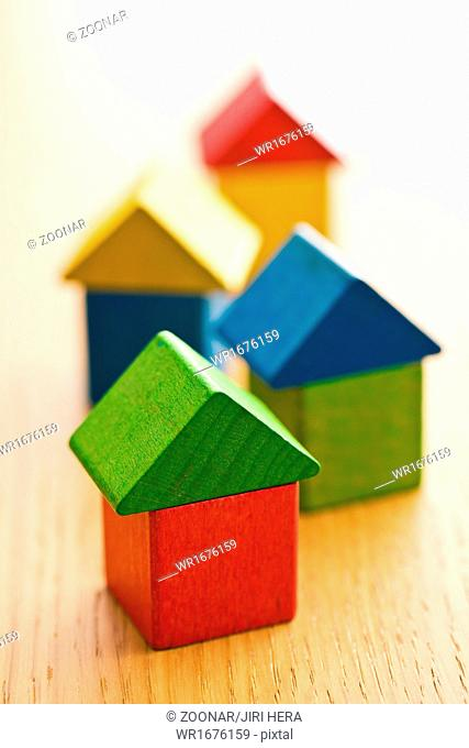 houses made from wooden toy blocks