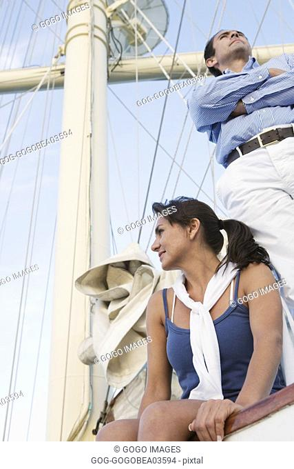 Couple sitting on ship's rigging