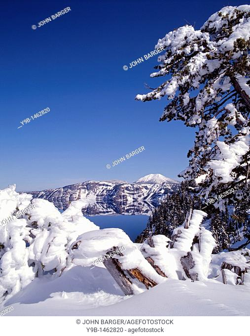 Winter snow accumulates at Crater Lake and on distant Mt  Scott, Crater Lake National Park, Oregon, USA