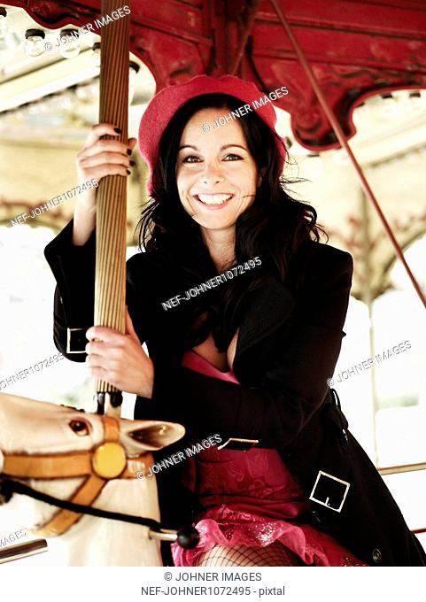 Portrait of fashionable woman on carousel