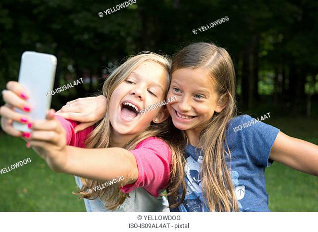 Girls taking selfie in garden