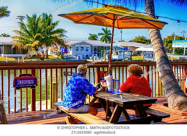 People sitting outside at Woody's People, Diners, waterfront Restaurant at St James City on Pine Island FL
