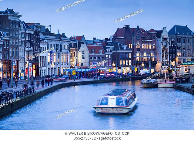 Netherlands, Amsterdam, city skyline by Rokin street, dusk