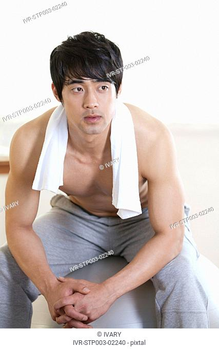 Asian Man Relaxing After Exercise
