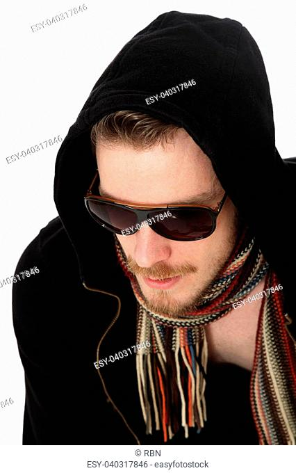 Close up of a man wearing sunglasses with a black hoodie, and a scarf. White background