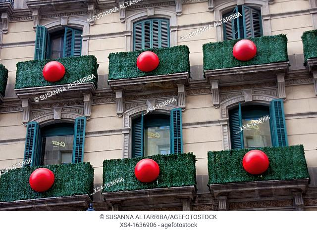 Balconies decorated in Portal del Angel, Barcelona, Spain, Europe