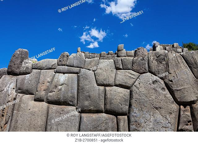 Precision fitted stonework of the massive Sacsayhuaman Incan fortress walls at Cusco, Peru