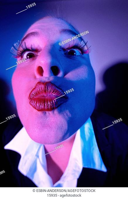 Woman makes kissy face