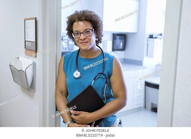 African American doctor holding digital tablet