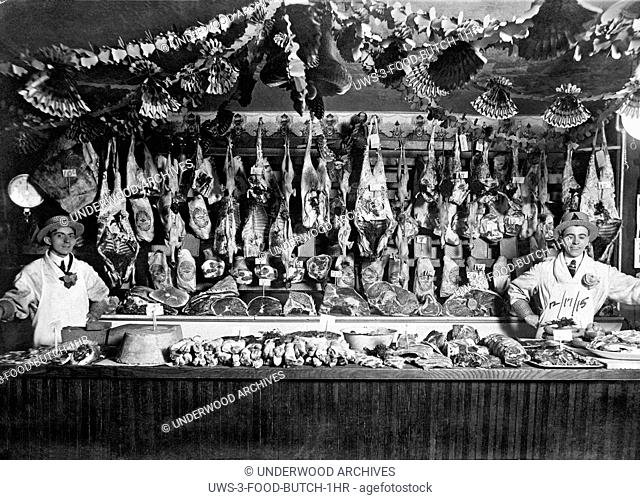 United States: December 17, 1915.Two butchers proudly display their products