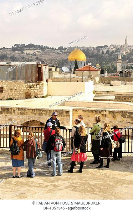 Tourist group during a tour on the roofs of old town Jerusalem, Israel, Middle East, the Orient