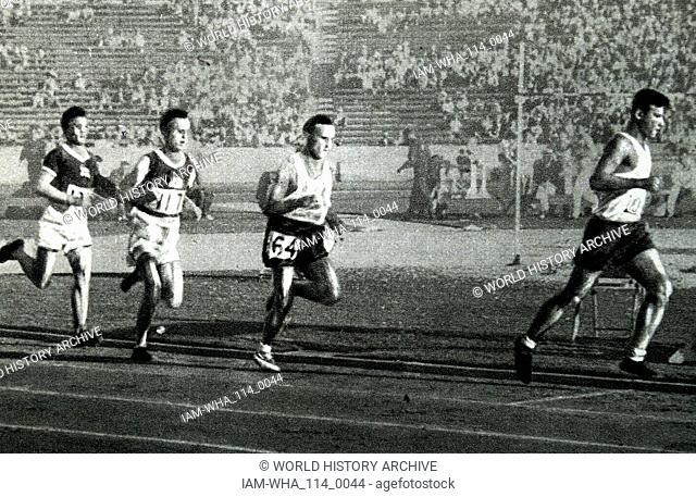 Photograph of Janusz Kusocinski (1907 - 1940) running in the 10000 Meter race during the 1932 Olympic games. Kusocinski won against the Finns Volmari Iso-Hollo...