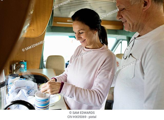 Couple making tea in motor home