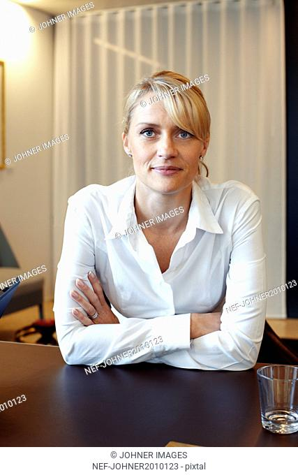 Businesswoman looking at camera