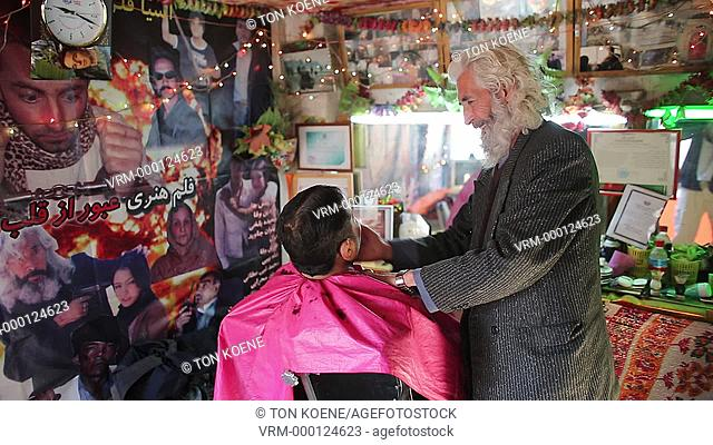 hair dresser at work in kabul, Afghanistan