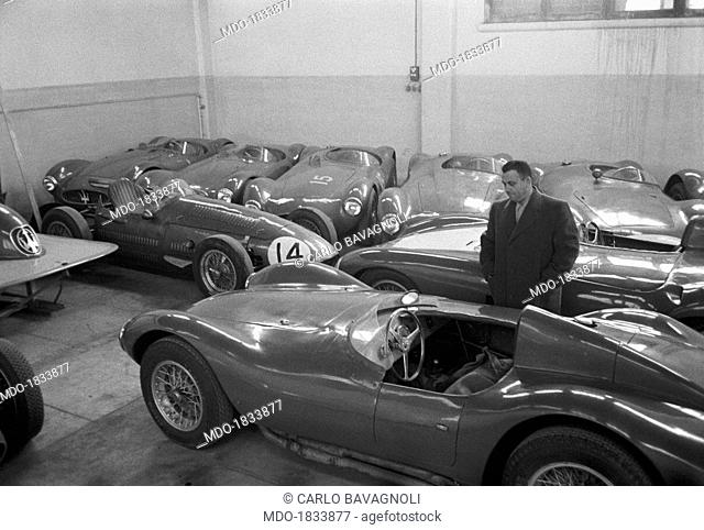 The billionaire entrepreneur Tony Parravano observing a race car into a Maserati garage. Modena, 1950s