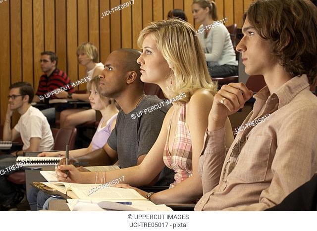 Students listening in auditorium