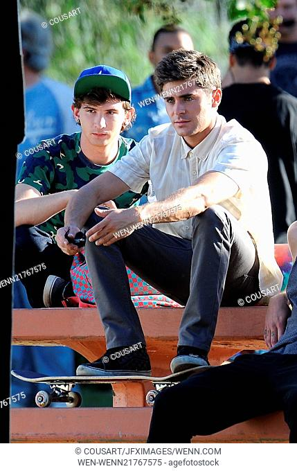 Actor Zac Efron filming a scene for his new movie 'We Are Your Friends'. In the scene he is seen smoking a fake marijuana joint and acting out a drug deal in a...