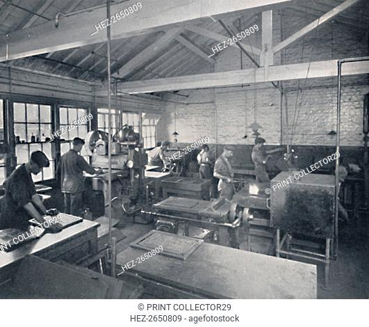 'At Work in the Foundry. Making Wax Moulds of the Pages', 1917. Artist: Unknown