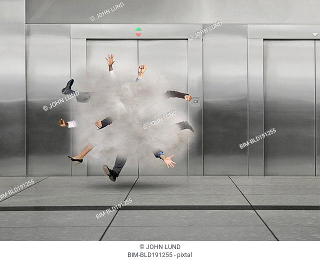 Business people fighting in ball near elevator