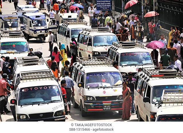 Mini buses are the major public transportation in Kathmandu at Kanthpas street