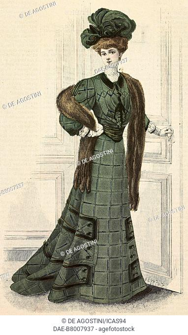 Woman wearing a green checkered woolen city dress, velvet inserts, mink stole and a hat with feathers, creation by Roubalski