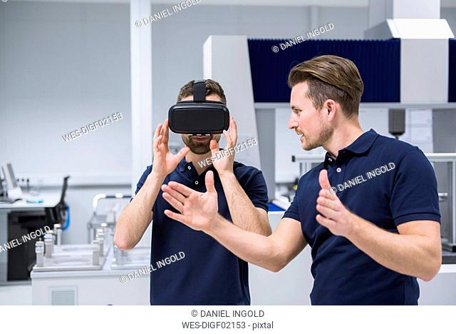 Two men in testing instrument room with VR glasses