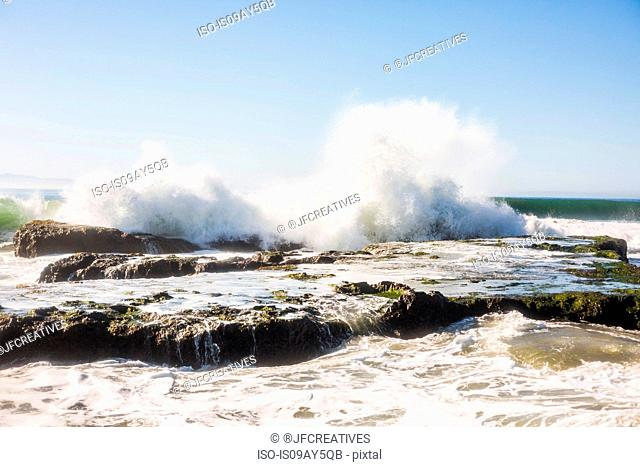 Waves splashing over rocks, Santa Barbara, California, USA