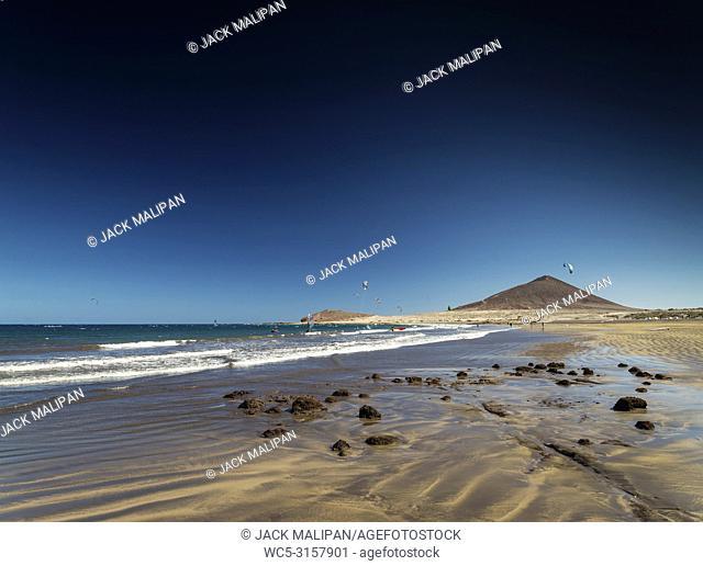 el medano tourist beach and montana roja famous landscape in tenerife spain