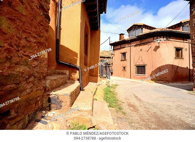 """Facade and street in Madriguera """"""""red village"""""""", Segovia, Spain"""