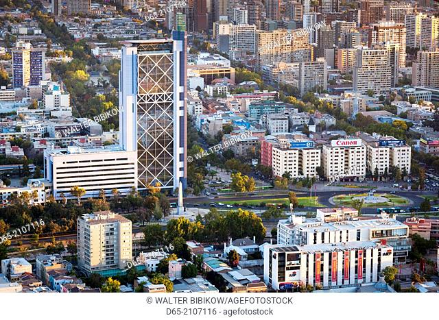 Chile, Santiago, elevated view of Plaza Baquedano and the Telefonica Tower from the Cerro San Cristobal hill, dusk