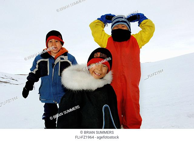 Portrait of three boys playing near Cambridge Bay, Nunavut