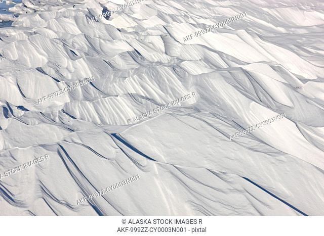 View of Sastrugi, wind carved ridges in the snow, along the Nenana River Southcentral Alaska, Winter