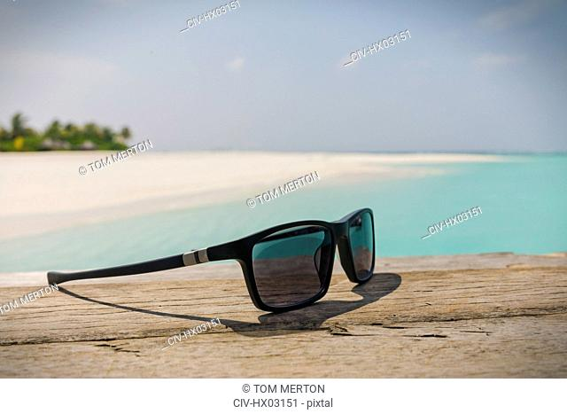 Close up sunglasses on sunny tropical beach