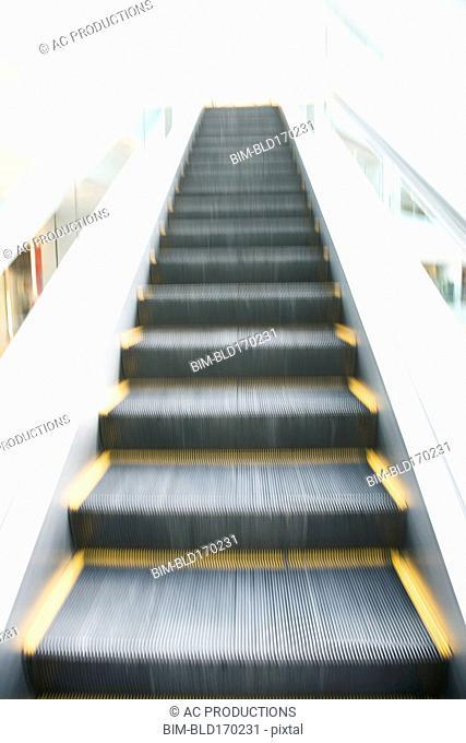 Blurred view of escalator steps